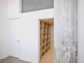 Attached storage wall to stairwell leads to mezzanine_13