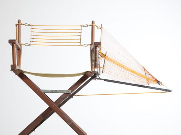 Designer repairs a chair with innovative structural components