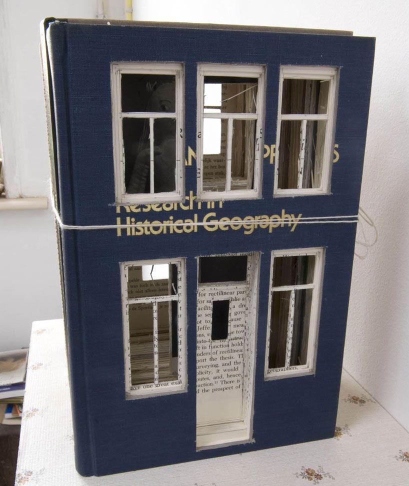 Frank Halmans carves house out of blocks of books