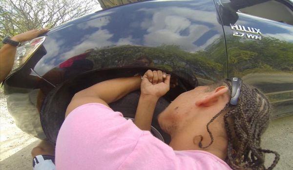 Live cat stuck inside her rental car_6