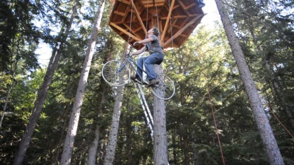 Ethan pedals his way to his treetop hideaway