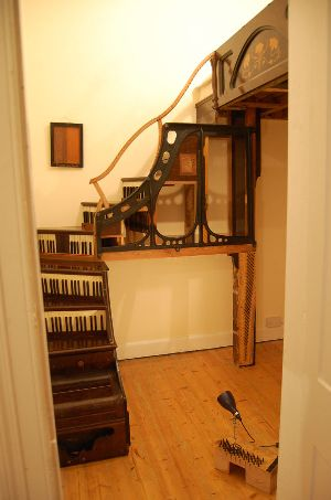 Staircase and bed made of pianos