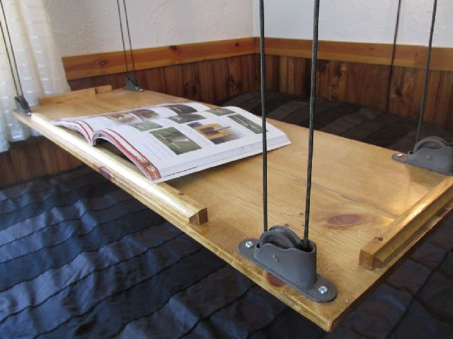pulley system for hanging bed table