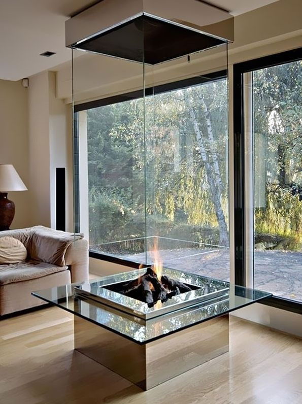 A fireplace 'and' a center table