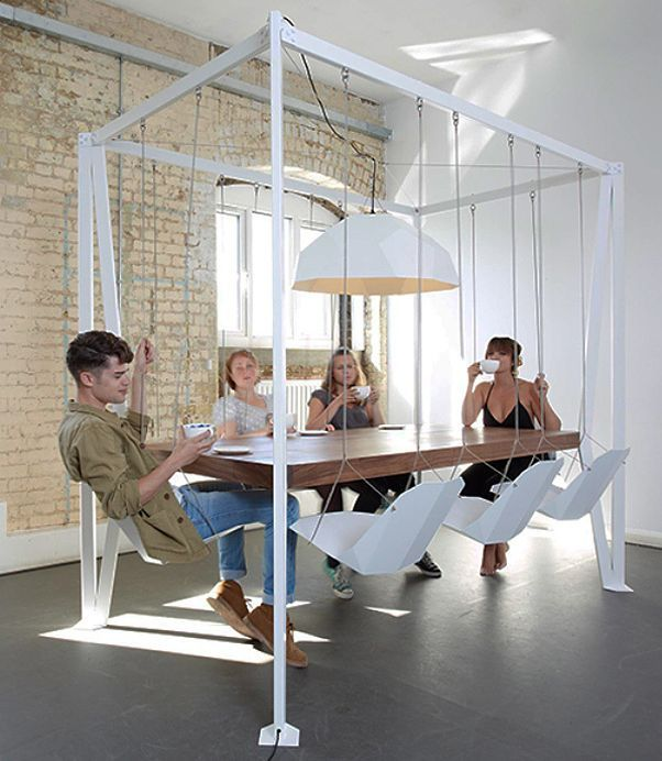 Dining table with swinging chairs