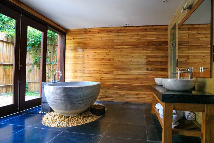 bathroom bathtub with wooden wall