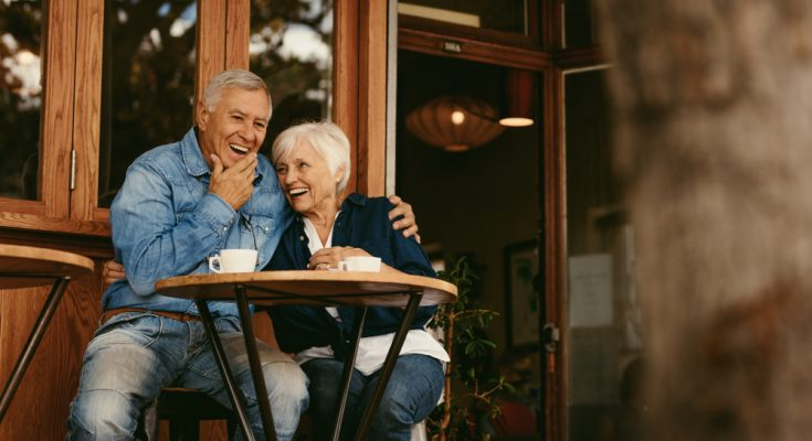 retired couple sitting at table