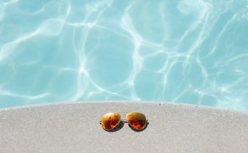 sunglasses near swimming pool